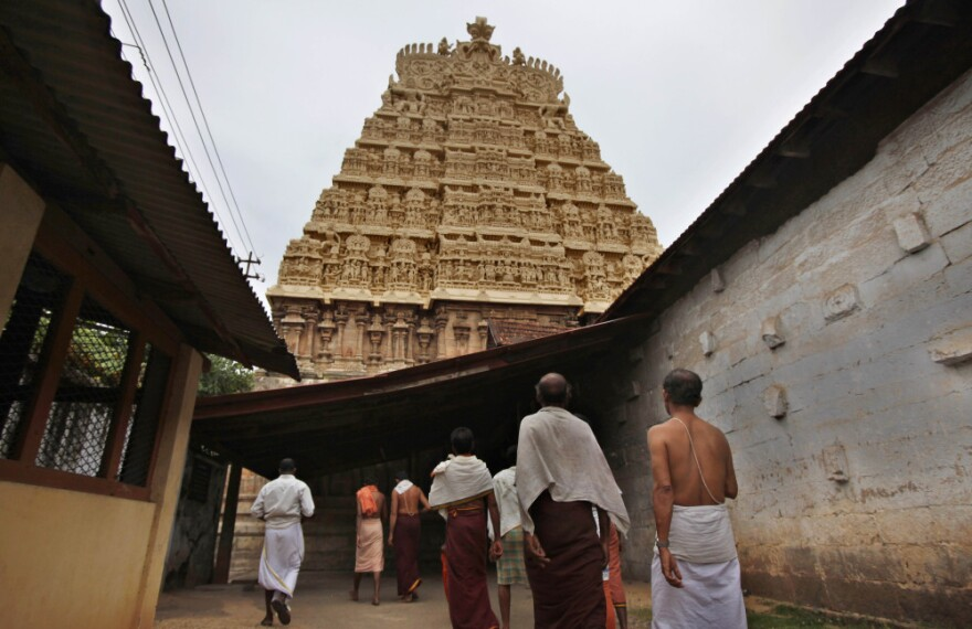 Devotees walk inside the premises of the 16th-century Sree Padmanabhaswamy Temple in Trivandrum, India.