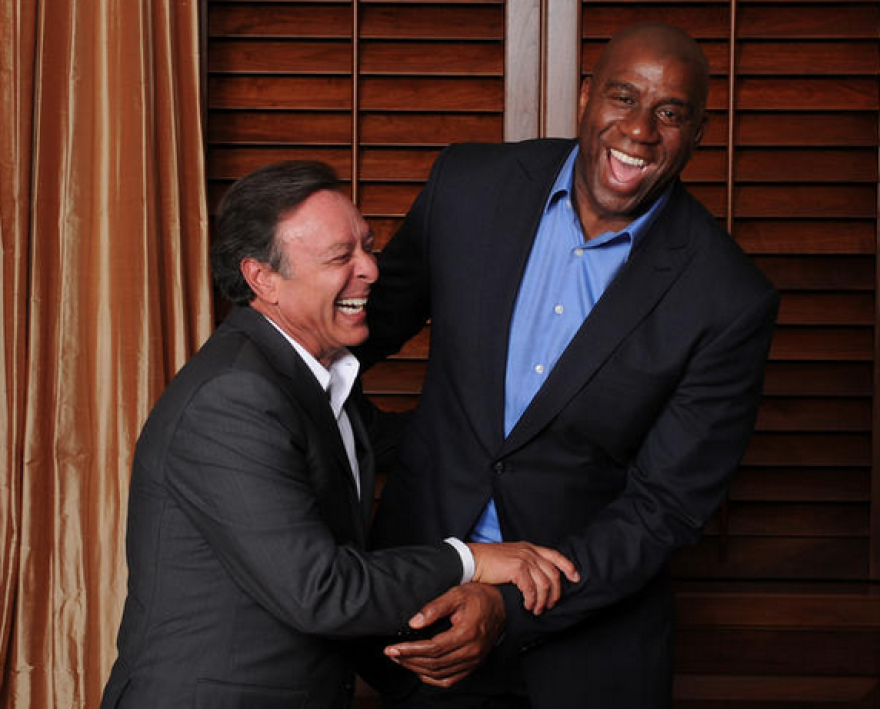 "Health care billionaire Mike Fernandez and Earvin ""Magic"" Johnson. Johnson became a strategic partner with the Fernandez-owned health insurance firm Simply Healthcare."