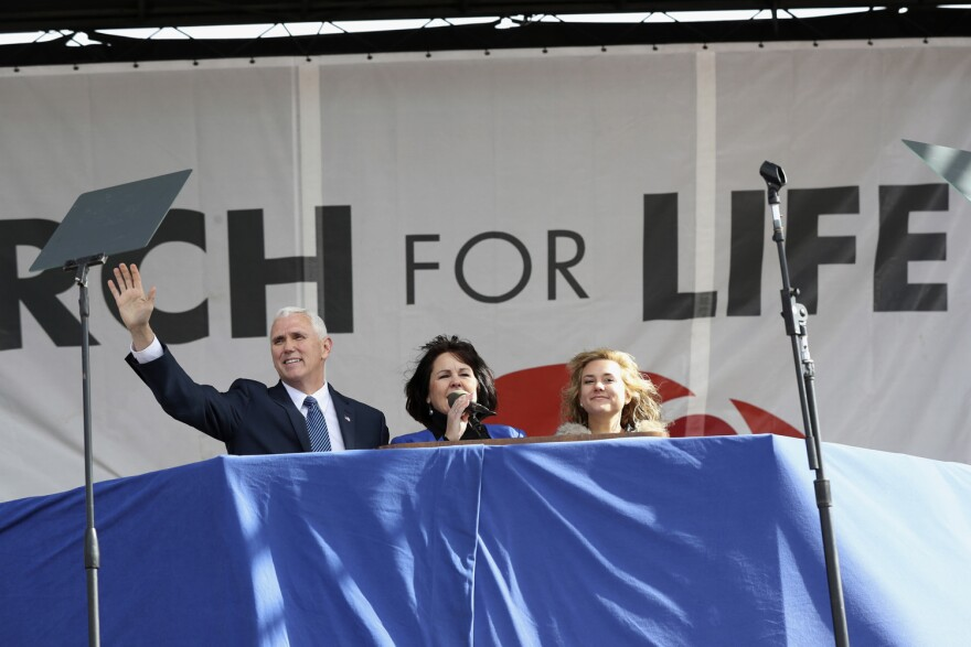 Vice President Mike Pence, with his wife Karen Pence, center, waves while speaking at the March for Life on the National Mall in Washington. (Manuel Balce Ceneta/AP)