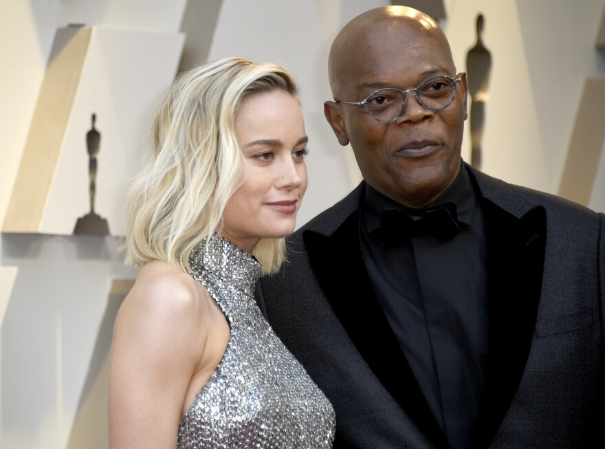 Brie Larson, left, and Samuel L. Jackson, right