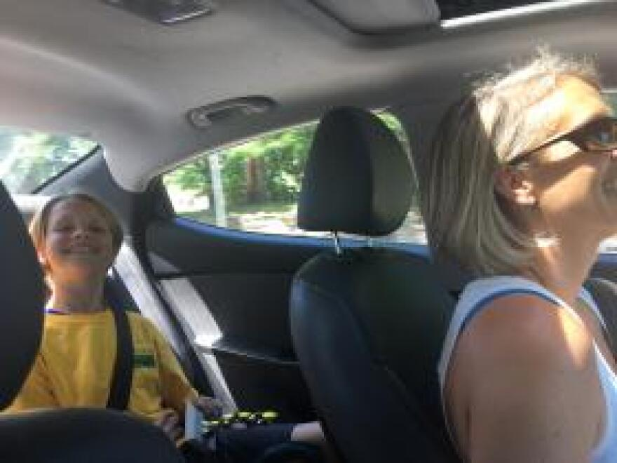 Military spouse Aleta Nims shuttles her son from one day camp to another.