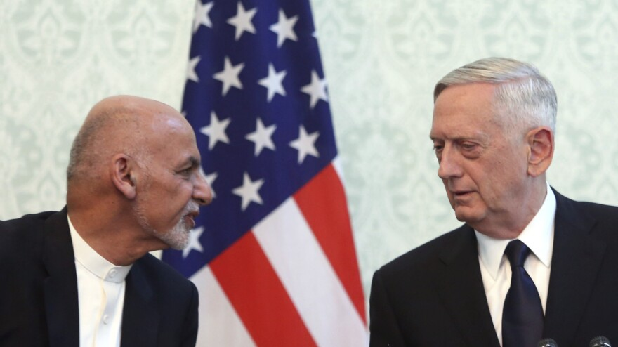 U.S. Defense Secretary Jim Mattis (right), with Afghan President Ashraf Ghani, arrived in Kabul on Wednesday. A rocket attack targeted Kabul's main airport on the same day.