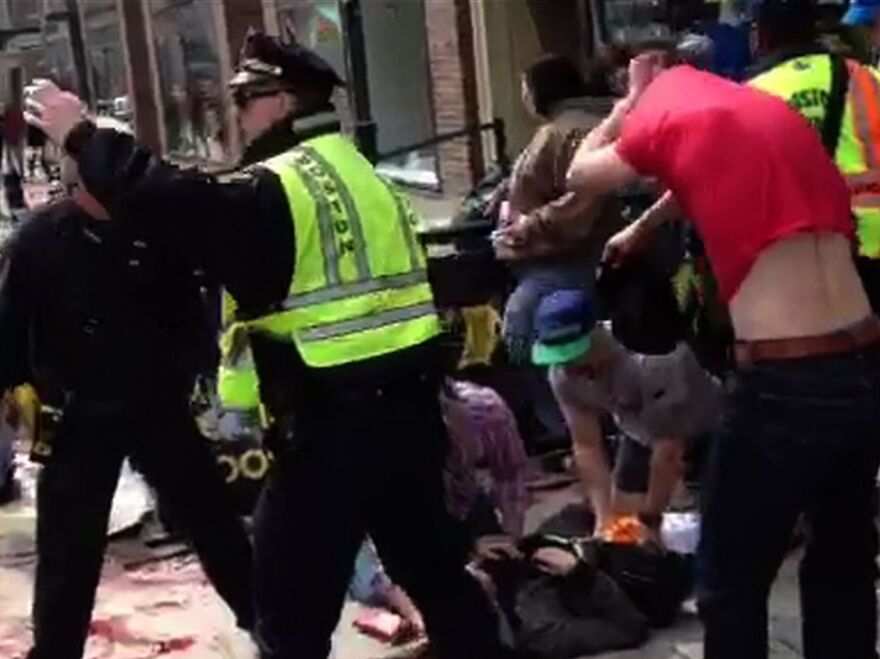 After the bombs went off Monday in Boston, bystanders, police and emergency personnel rushed to help those who were caught in the blasts, as this video image shows.