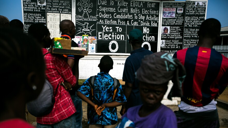 The Daily Talk uses chalk, photos and Liberian slang to spread the latest news. Editor Alfred Sirleaf set up the blackboard on Monrovia's main thoroughfare.