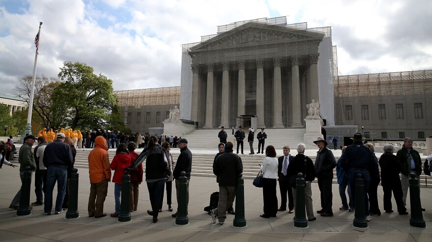 People line up to enter the U.S. Supreme Court on Tuesday. All of the court's archived audio, dating back to 1955, has now been digitized for public access online.