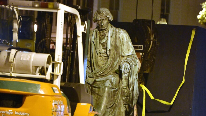 Crews worked to remove the statue of Supreme Court judge and segregationist Roger Taney from the front lawn of the Maryland State House late Thursday night. Taney wrote the 1857 <em>Dred Scott</em> decision that defended slavery and said black Americans could never be citizens.