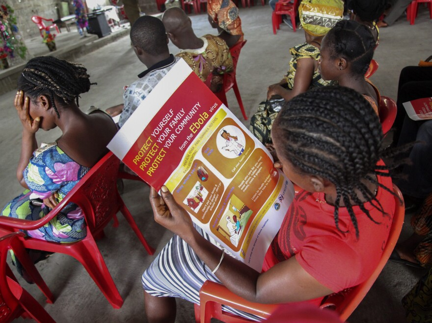 A woman reads about Ebola during a prevention campaign by UNICEF at the Mission for Today Holy Church, in Monrovia, Liberia, on Sunday.