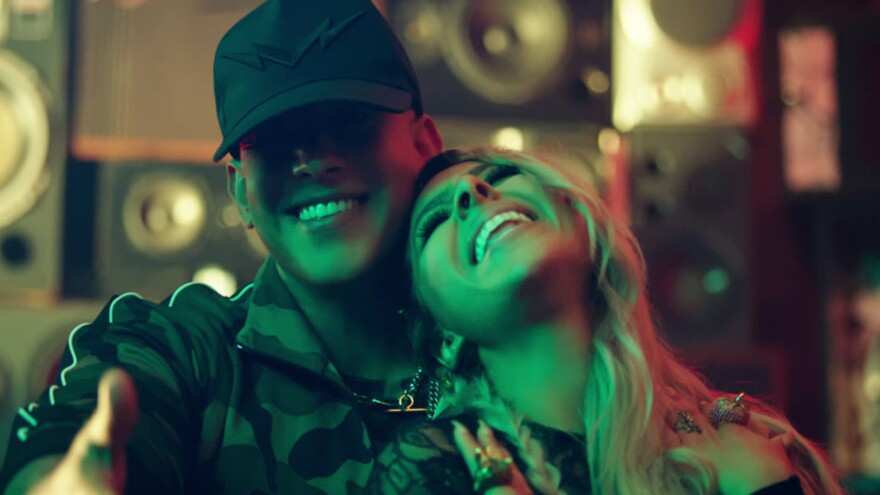 """In """"Como,"""" the undisputed king of reggaeton joins forces with newcomer Kim Viera for an <em>urbano</em> reinvention of the summer love song."""