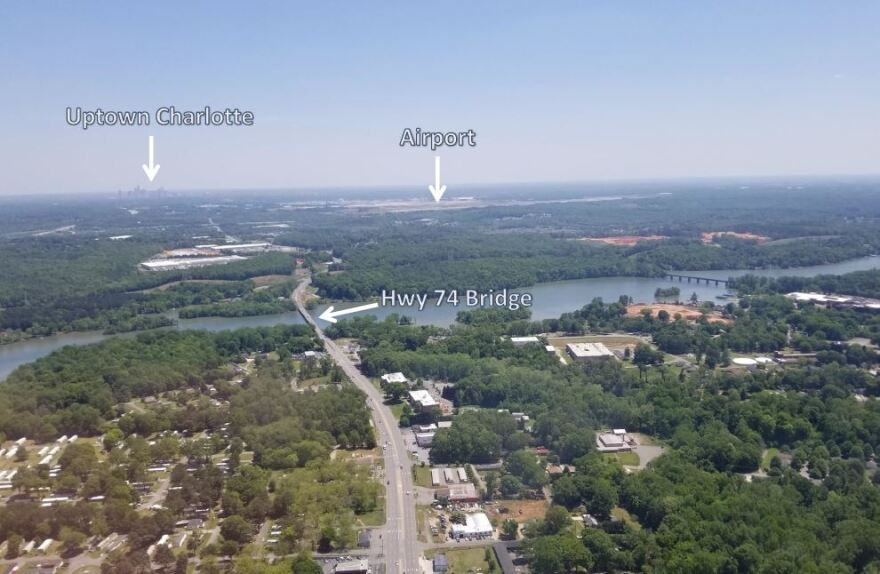 Aerial view shows Wilkinson Boulevard in downtown Belmont heading east toward the airport and uptown Charlotte.