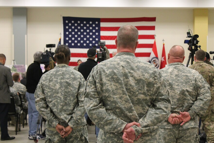 "National Guard members stand at a news conference to discuss ""Operation Recovery"" at the Jefferson Barracks Division in St. Louis."