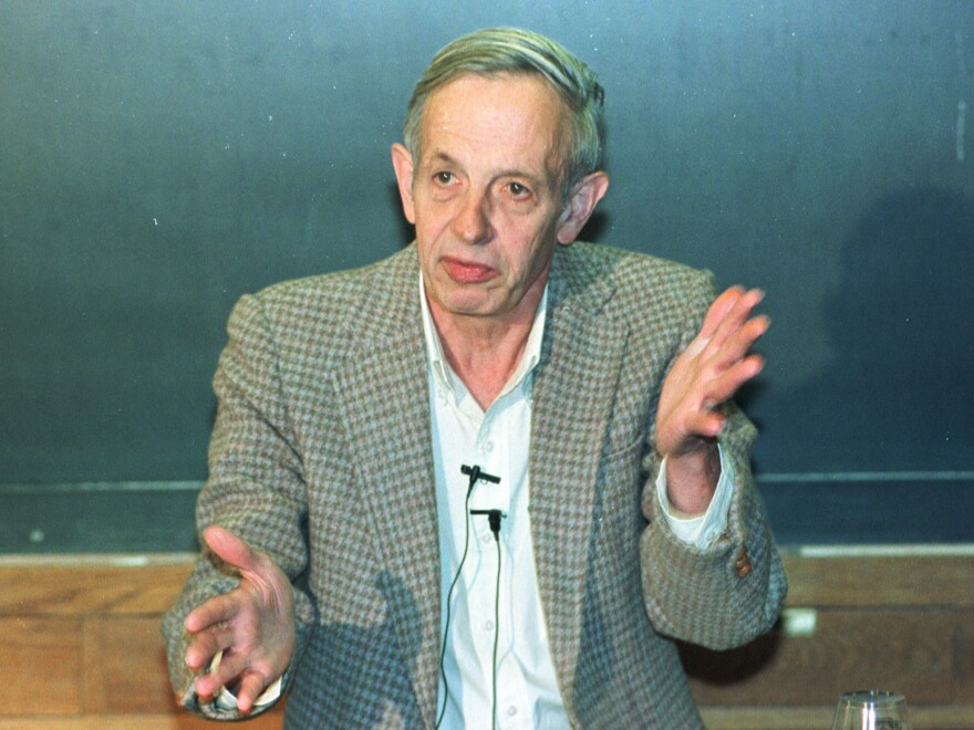 Princeton University professor John Nash speaks during a news conference at the university in Oct. 1994 after being named the winner of the Nobel Prize for economics.