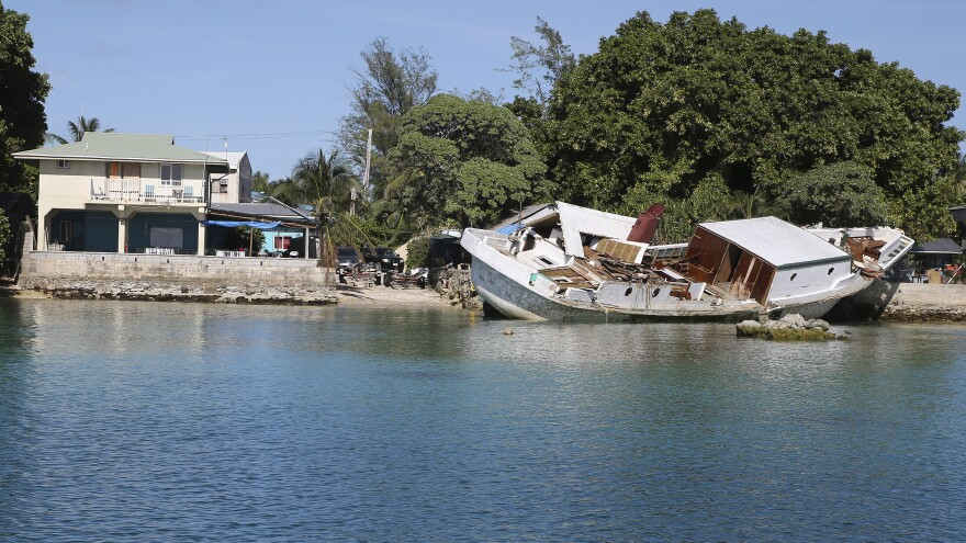 A boat lies wrecked and stuck on a sea wall after it crashed into the back of de Brum's house on Majuro Atoll in the Marshall Islands. A huge tide hit the atoll on July 3, causing massive flooding and damage. Climate change is causing sea levels to rise and is leading to more extreme weather, according to climate scientists.