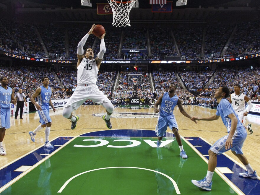 Julian Gamble of the Miami Hurricanes driving to the basket during his team's win Sunday over North Carolina. The 'Canes are ACC champions. Both teams will be in the NCAA tournament.