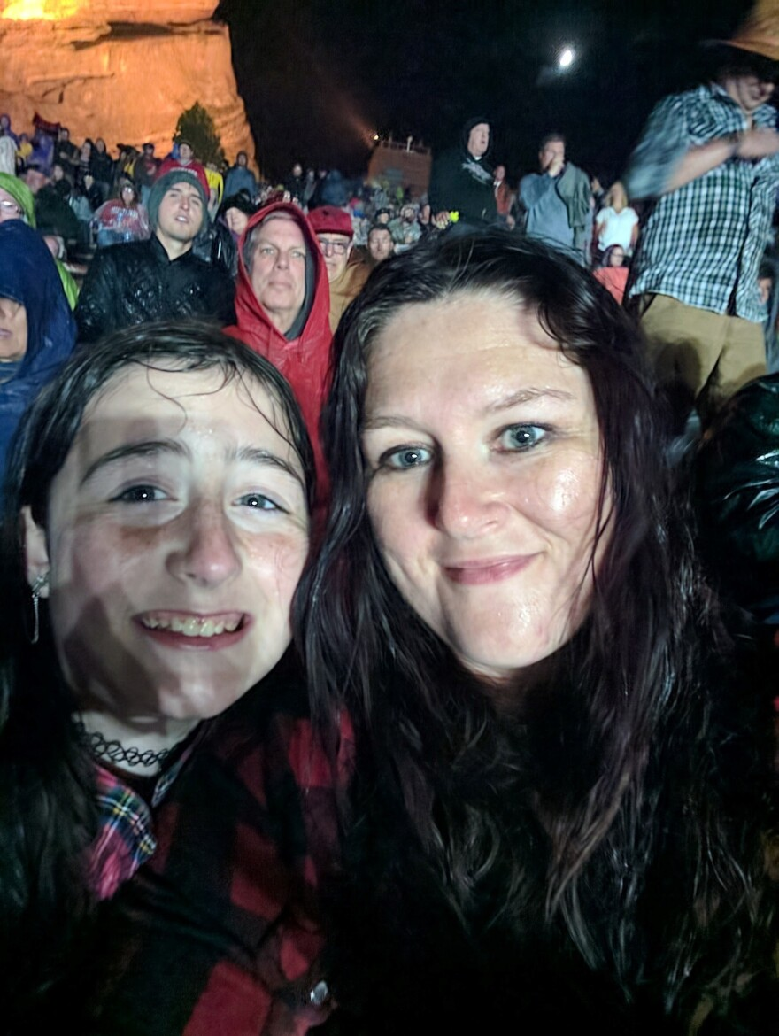 Sara Register with her daughter, Rhiannon, at a Tom Petty concert at Red Rocks, Colo., during his final tour in 2017. A huge rainstorm soaked the crowd.