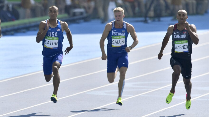 Eaton (left) competes Wednesday in the 100 meters, the first of the 10 events in the decathlon. His time was 10.46. Estonia's Karl Saluri is in the center, while Canada's Damian Warner (right) had the fastest time in the event, 10.35. Warner is considered one of Eaton's main challengers for the gold.