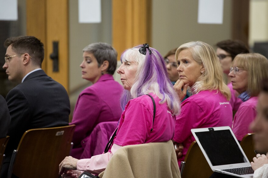 Supporters of Planned Parenthood listen to opening statements on the first day of the administrative hearing. Oct. 28, 2019