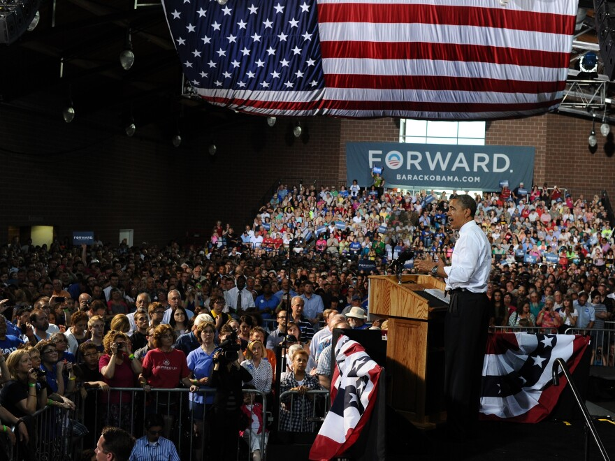 President Obama tossed a cowpie charge at Republican Mitt Romney, Thursday, May 24, 2012, in Des Moines, Iowa.