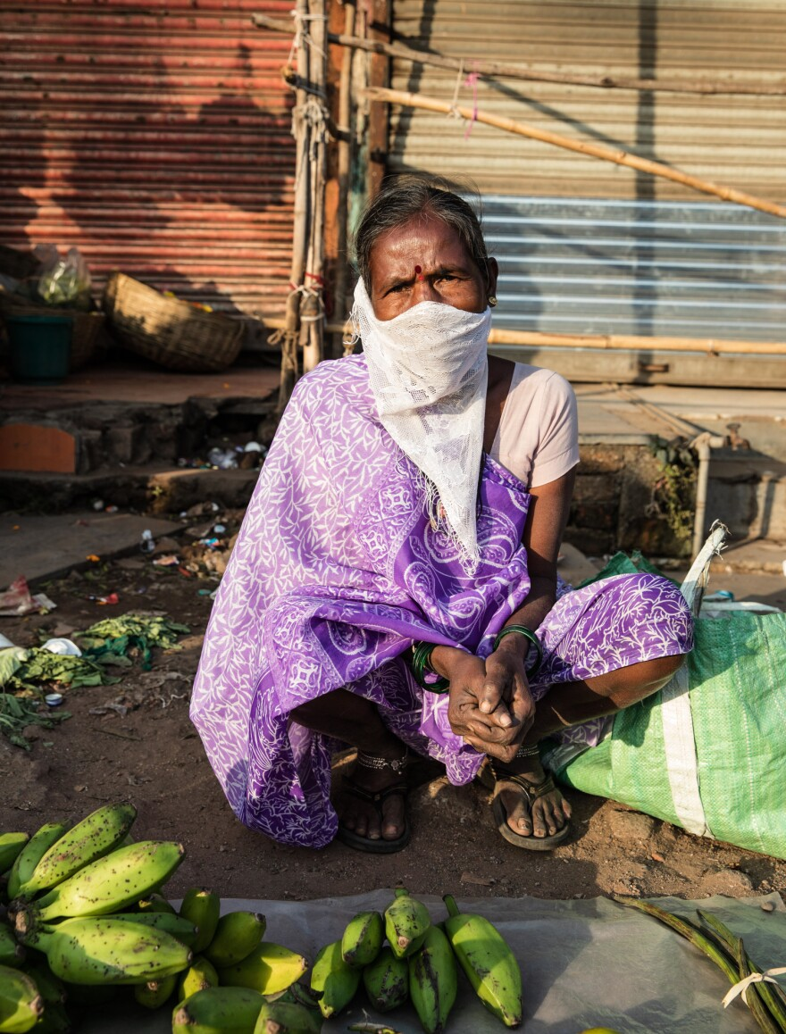 """Asked if she'll take the vaccine, vegetable vendor Kunta Dubra replies, """"Why would I take medicine if nothing's wrong with me?"""""""