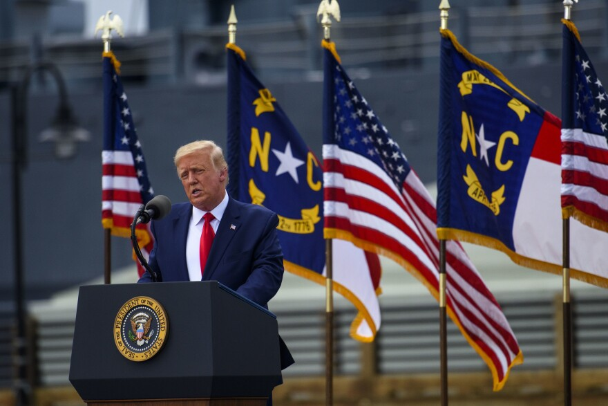 President Trump visited Wilmington, N.C., on Wednesday and urged supporters to try to vote in person after sending in a mail-in ballot — actions that would be both illegal and disruptive.