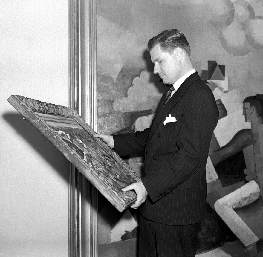 Nelson Rockefeller examines a painting at New York's Museum of Modern Art in 1939. Rockefeller was 23 when he hired Diego Rivera to paint a mural in the newly built Rockefeller Center.