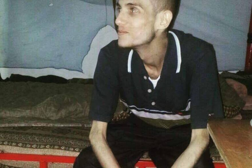 Omar al-Shogre says he spent 10 months in Sednaya prison. He says he was arrested at age 17 and was in various Syrian prisons for more than two years before he was sent to Sednaya.