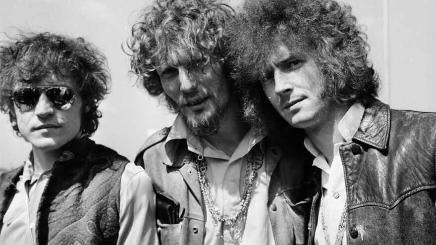 """Jack Bruce, left, seen here with fellow Cream members Ginger Baker (center) and Eric Clapton in 1967, has died. The bassist sang such hits as """"Sunshine of Your Love."""""""