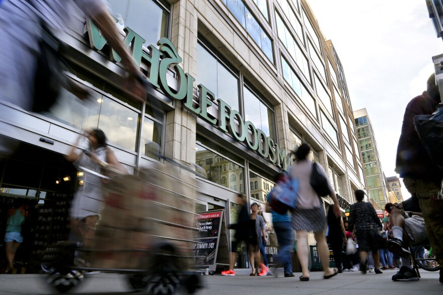 """Amazon says Whole Foods stores will continue to operate under their own brand and will continue to source products """"from trusted vendors and partners around the world."""""""