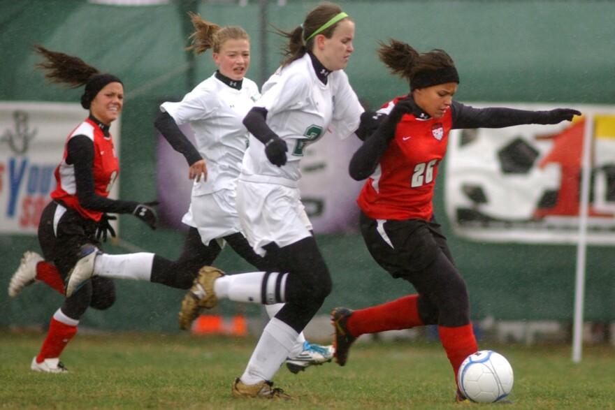 Players take part in a soccer match. (Jon C. Hancock/AP)