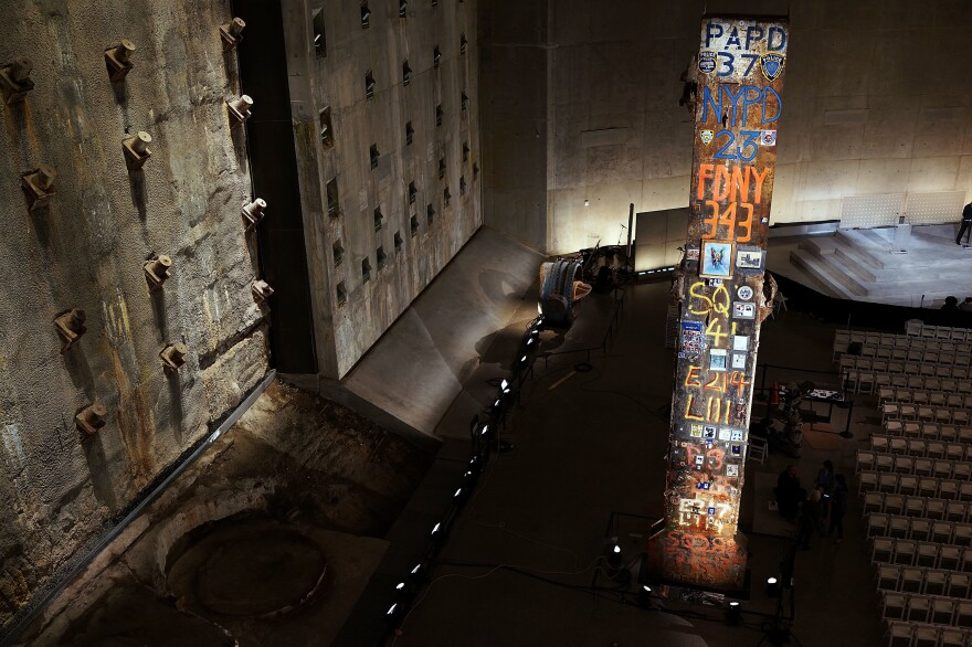 The last steel column removed from the ruins of the World Trade Center and the Slurry Wall at the National September 11 Memorial and Museum in New York City.