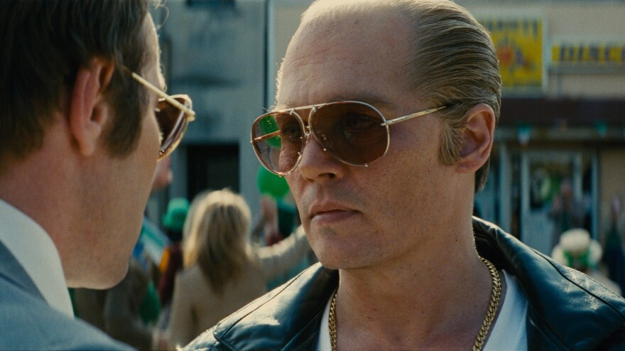 """Johnny Depp plays James """"Whitey"""" Bulger, a notorious gangster who collaborated with the FBI to take down a rival Mafia family."""