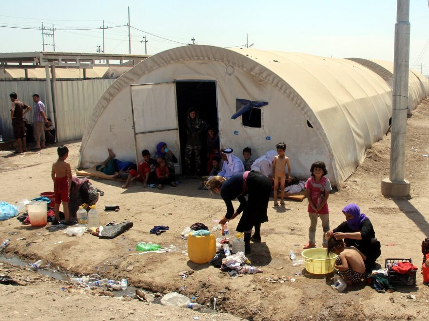Yazidi women wash their children at a refugee camp near the Iraqi border crossing of Zakho in August.