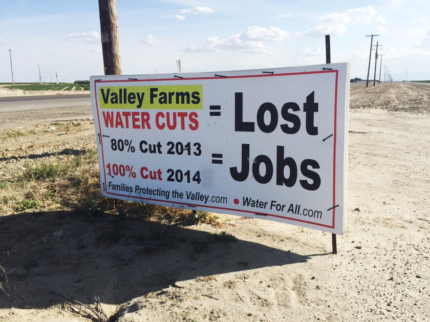 Within the boundaries of the Westlands Water District, handmade signs near fallowed fields protest federal water policy.