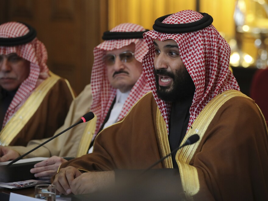 Saudi Crown Prince Mohammed bin Salman conducts a meeting with Britain's Prime Minister Theresa May with other members of their delegations, in London, on March 7.