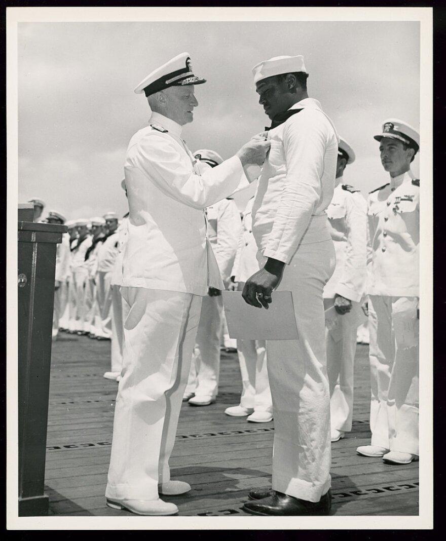 Admiral giving Doris Miller Navy Cross