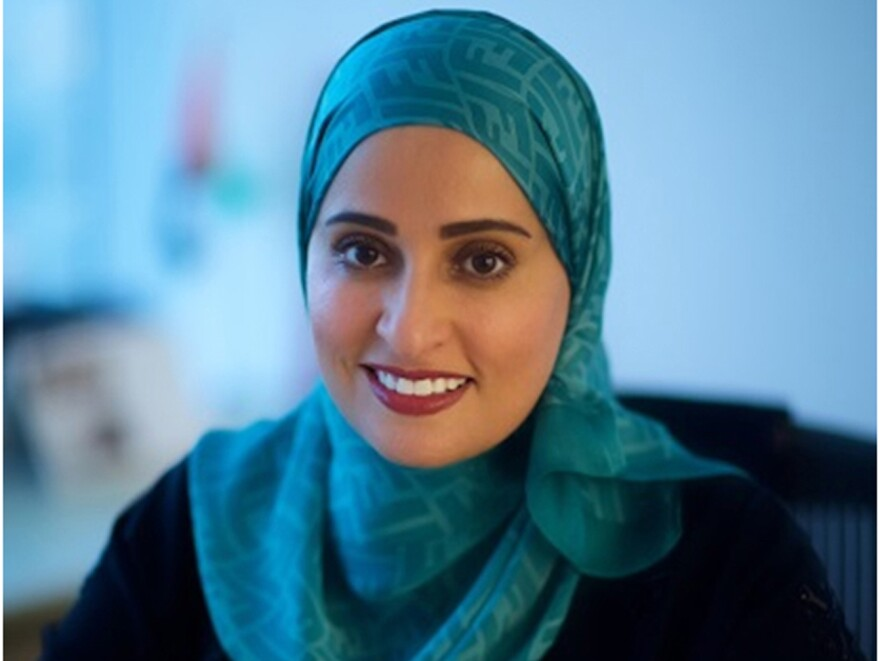 This undated image released by the Emirates News Agency, WAM, shows Ohood Al Roumi, the newly appointed and first-ever minister of state for happiness of the United Arab Emirates.