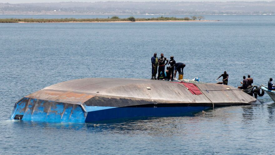 Tanzanian rescue workers search for victims after the ferry MV Nyerere capsized in Lake Victoria.