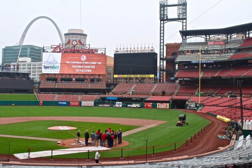 The grounds crew works on the field at Busch Stadium last week. Construction was still under way on the Budweiser Terrace, a new social gathering area in the upper right field seating sections. It will feature lounge seating, standing areas and two bars.