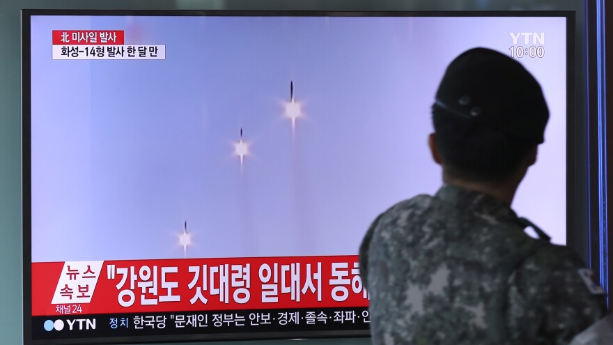 A South Korean soldier at the Seoul Train Station watches footage of North Korea's missile launch on Saturday.