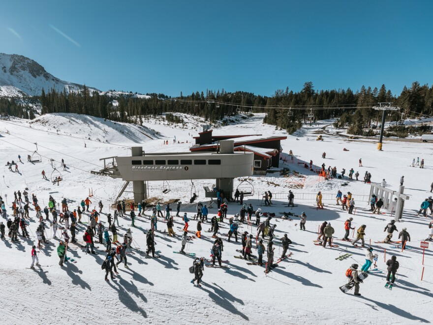 Skiers and snowboarders wait in a socially distanced lift line at Mammoth Mountain on Nov. 15.