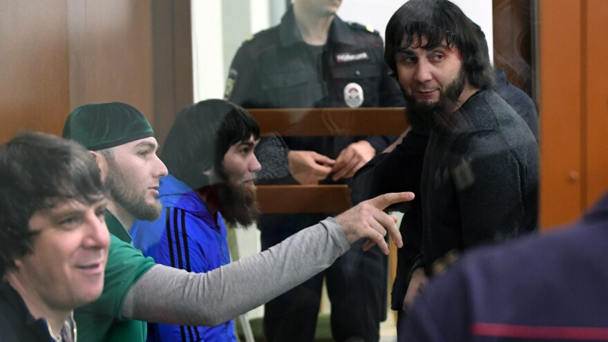 Zaur Dadayev (right) was convicted of carrying out the assassination of politician Boris Nemtsov in February 2015. He's seen here in court last month, inside a defendants' cage during a hearing at the Moscow District Military Court.