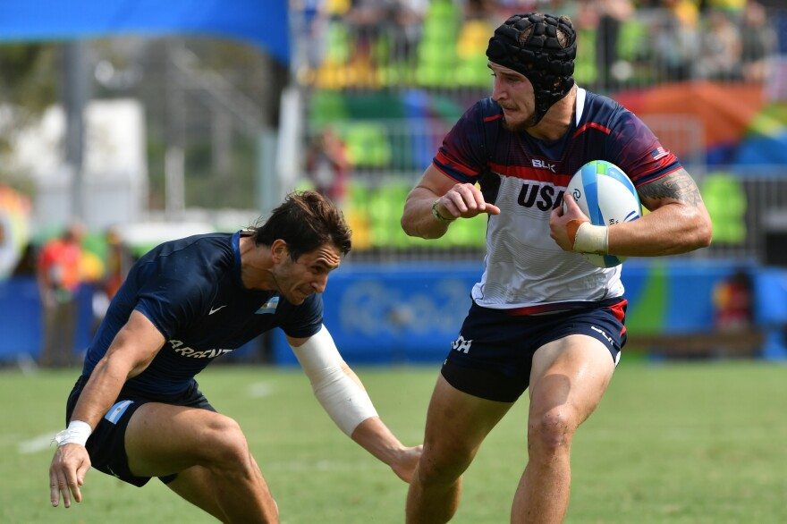 USA's Garrett Bender (right) runs with the ball in the men's rugby sevens match against Argentina during the Rio 2016 Olympic Games on Tuesday.