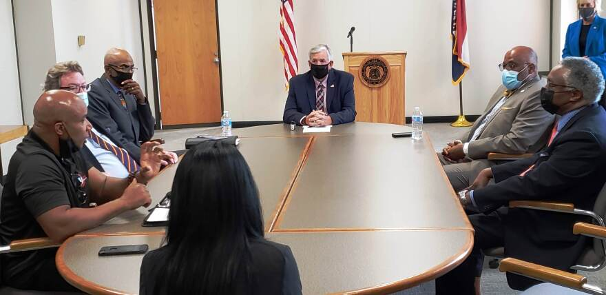 Gov. Mike Parson meets with leaders from the Urban League, ARCHS and other anti-violence groups in St. Louis on Sept. 9, 2020.