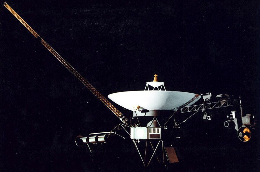 """This artist's illustration shows the Voyager 1 space probe. The spacecraft was launched on Sept. 5, 1977, and as of August 2012, it is outside the bubble of hot gas, known as the """"heliopause,"""" that radiates from the sun."""