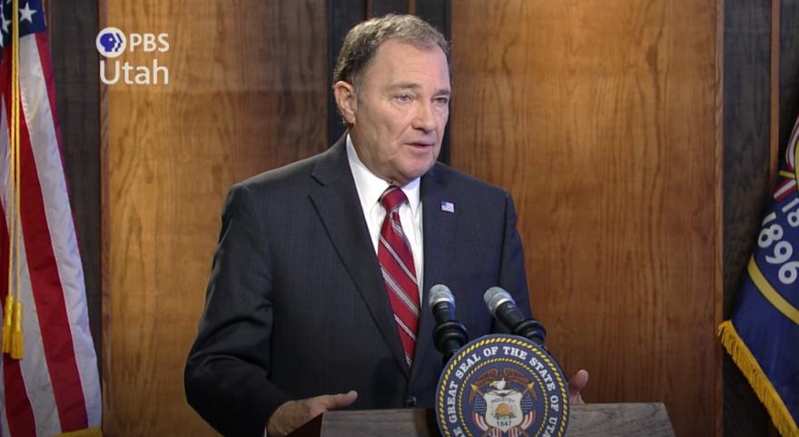 Screengrab from video of Gary Herbert speaking at a podium