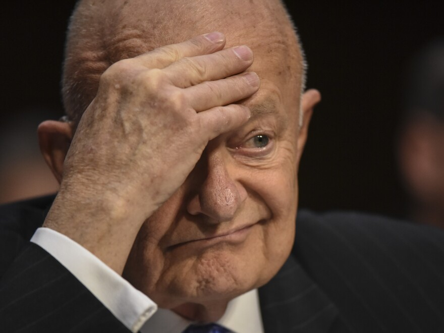 Former Director of National Intelligence James Clapper listens to a senator's question during his testimony before a Senate Judiciary subcommittee on Russian interference in the 2016 election.