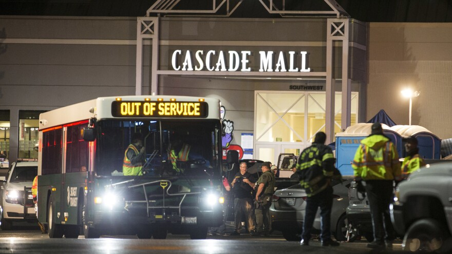 Emergency personnel gather at an entrance to the Cascade Mall in Burlington, Wash., after five people were killed there on Sept. 23, 2016.