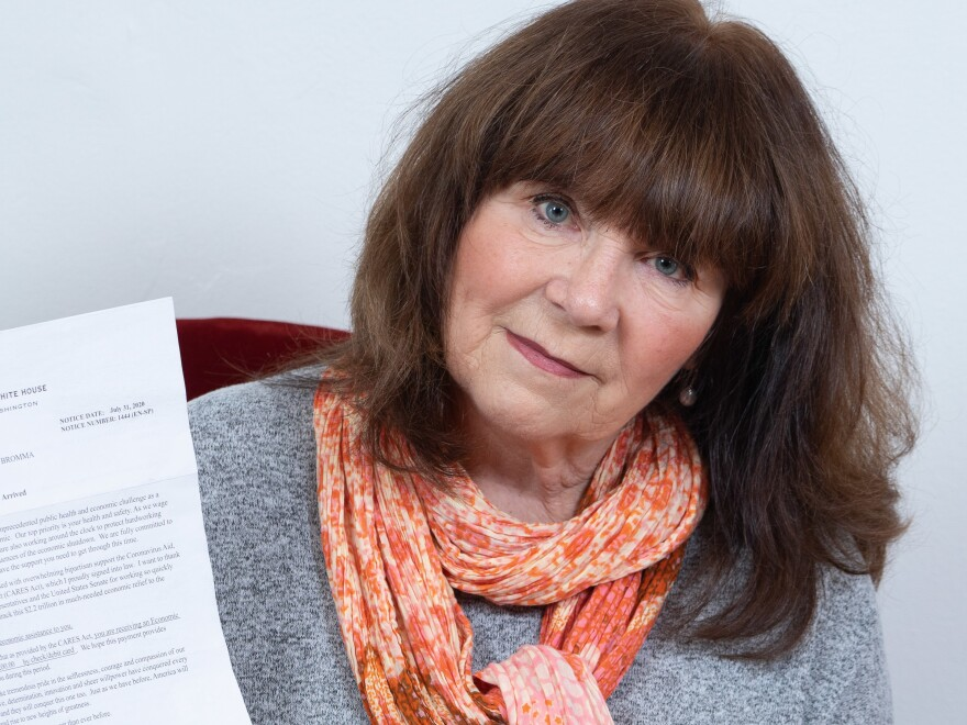 Susanne Wigforss, a Swedish citizen, poses with the letter she received from the White House about the $1,200 economic impact payment she received.