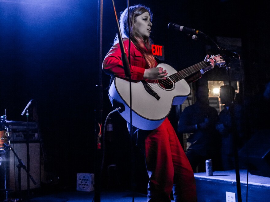 Armored in a stellar red jumpsuit and Converse, Jade Bird wows the crowd at Dallas' Club Dada in Deep Ellum. She'll return to Dallas for KXT's signature concert series <em>KXT Sun Sets</em> on June 19.