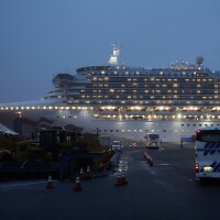 Buses arrive at Yokohama Port, near Tokyo, as the Japan Self-Defense Forces prepare to move American passengers from the quarantined Diamond Princess cruise ship on Sunday.