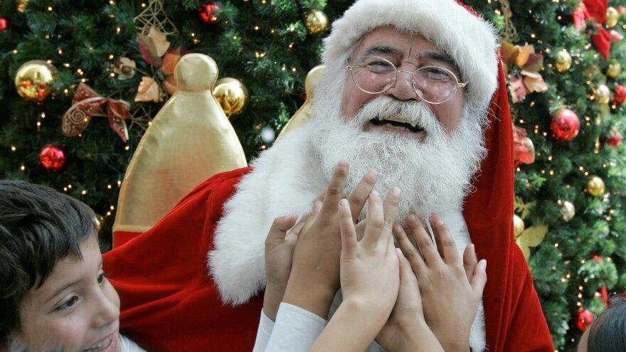 Children feel Santa's beard at a shopping mall in Santiago, Chile.
